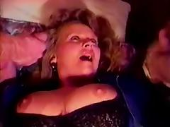 Mature slut has sex with two men in retro video porn video