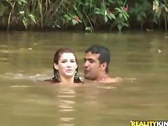 Sexy Dani Duran swims in a lake and fucks on a lawn