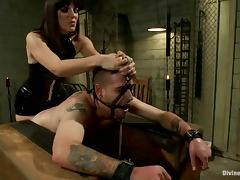 Bobbi Starr gears Scott's cock and charges him with electrodes