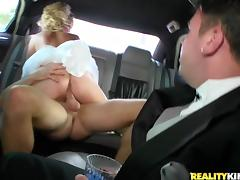 Hot milf gets fucked in a limousine in her wedding dress