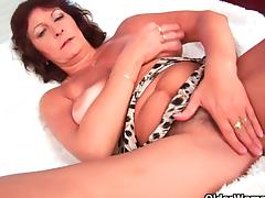 Busty grandma rubs and fingers her hairy cunt porn video