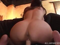 Japanese hottie sucks a dildo before poking it in her juicy pussy