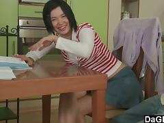 Amateur Asian slut is getting herself a good hard fucking in the kitchen