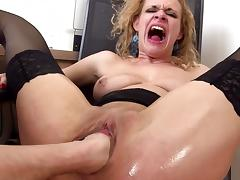 Sexy curly-haired babe is getting fist in puss