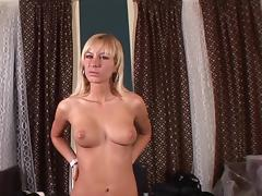 Bleached Deniska is stretching her pussy