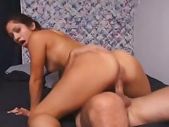 Brunette sucks on a cock and then sits on it