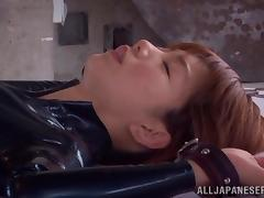 A slim Japanese girl in leather bodysuit gets fucked rough