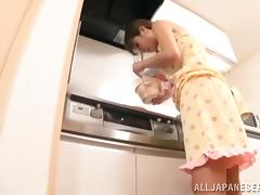 A busty Japanese housewife gets toyed in a kitchen