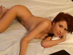 Busty redhead strips on webcam