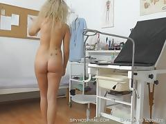 Hidden cam records blonde babe during vagina check-up