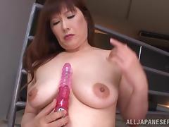 A Japanese MILF toys her pussy and sits on guy's face