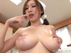 A Japanese nurse strokes a cock and gives a blowjob