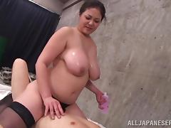 Nanako Mori titty fucks a horny guy with her massive breasts