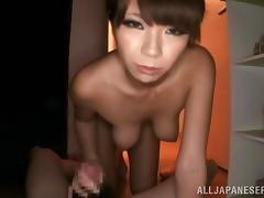 Japanese tart fingers her cunt and sucks a dick in a bathroom