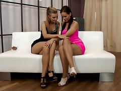 Two eye catching lesbians have fun on the white couch