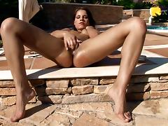 Venus favours herself with fingering on the poolside