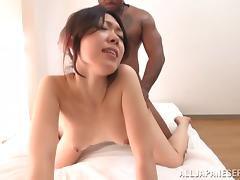 Japanese cutie gets her pussy smashed by a bulky black man