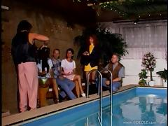 Pool party group sex among hot babes and horny guys in vintage clip