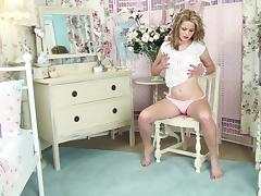 Curvy blonde Louise Emerson pleases herself with fingering indoors