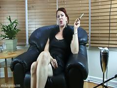 Redhead milf Mina smokes and masturbates her shaved cunt