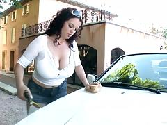 Sexy babes show off their huge tits while washing a car