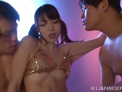 Megumi Shino naughty Asian milf blows two cocks