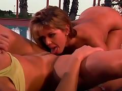 British Milf Nici Stirling in lesbian Strap-on action