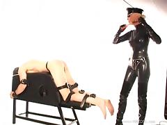 Mistress Alexandra plays with a guy's cock in bondage video