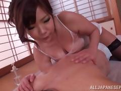 Pretty Japanese lady with big knockers gets oiled and teased