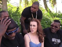 Lewd redhead enjoys interracial gangbang in reality video