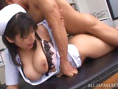 asian nurse in uniform with big tits rides hard cock
