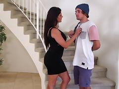 Brunette mom gives a blowjob and a titjob on the stairs