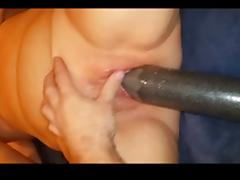 Wife taking a huge home made dildo in her pussy