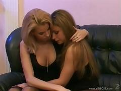 Two red hot lesbian babes play with a variety of toys