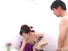 Eriko Miura gives a blowjob and a titjob to a dude in a bathroom