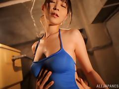 Rei Aimi allows a man to rub her big oiled tits and pussy