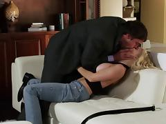 Pornstar Jesse Jane rides and milks cock on the couch hardcore style