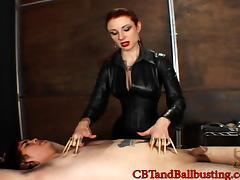 Vivacious babe with a fetish in leather attire ball busting her dude tied up like a slave