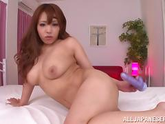 Chubby Asian cowgirl with long hair and big tits moaning as her hairy pussy gets smashed with a toy