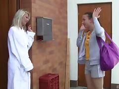 A blonde and a brunette lick each other's pussies in the bathroom